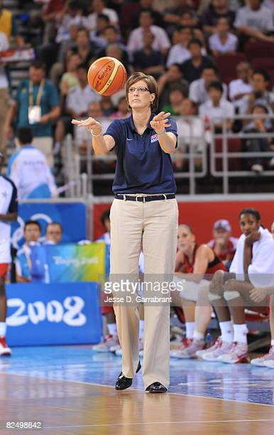 Head Coach Anne Donovan of the US Women's Senior National Team gets a loose ball against Russia during the women's semifinals basketball game at the...