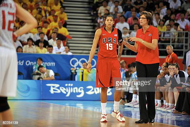 Head Coach Anne Donovan talks to Candace Parker of the US Women's Senior National Team during day 3 of the women's preliminary basketball game...
