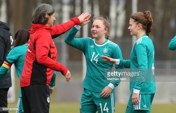 Head coach Anouschka Bernhard Madeleine Steck and Emilie Bernhardt of Germany show their delight after winning the UEFA U17 Girl's European...