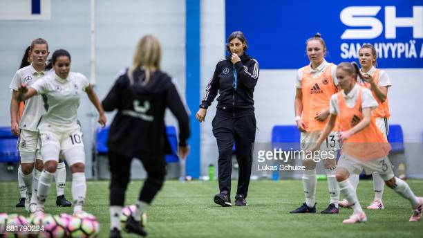 Head Coach Anouschka Bernhard of Germany acts during warmup prior to the U17 Girls friendly match between Finland and Germany at the Eerikkila Sport...