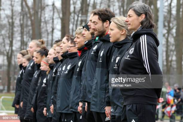 Head coach Anouschka Bernhard of Germany and her team look on prior to the UEFA U17 Girl's European Championship Qualifier match between Germany and...