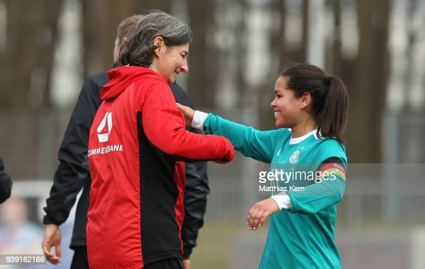 Head coach Anouschka Bernhard of Germany and Ivana Fuso show their delight after winning the UEFA U17 Girl's European Championship Qualifier match...