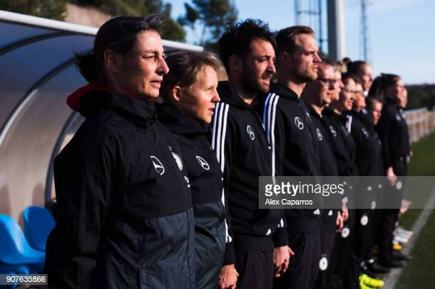 Head Coach Anouschka Bernhard of Germany and staff members look on during the national anthems ceremony before the U17 girl's international friendly...