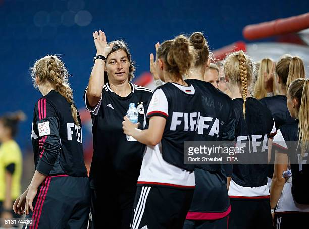AZ ZARQA' JORDAN OCTOBER 07 Head coach Anouschka Bernhard of Germany celebrates with team mates after winning the FIFA U17 Women's World Cup Group B...