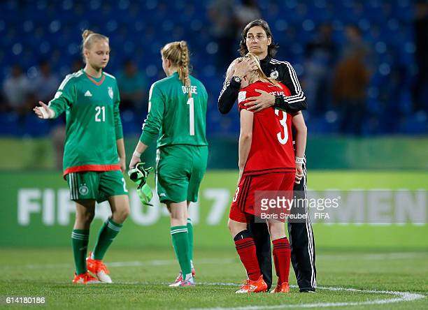 Head Coach Anouschka Bernhard of Germany comforts Caroline Siems of Germany after losing the FIFA U17 Women's World Cup Quarter Final match between...