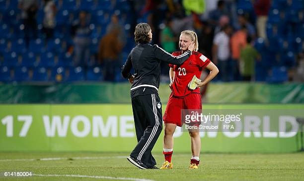 Head Coach Anouschka Bernhard of Germany comforts Lisa Schoeppl of Germany after losing the FIFA U17 Women's World Cup Quarter Final match between...