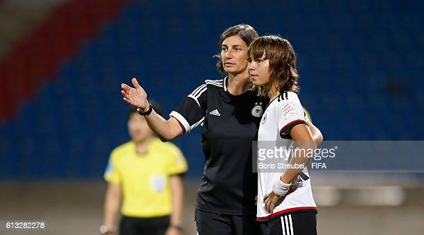 AZ ZARQA' JORDAN OCTOBER 07 Head coach Anouschka Bernhard of Germany gives advicees to Lena Oberdorf during the FIFA U17 Women's World Cup Group B...