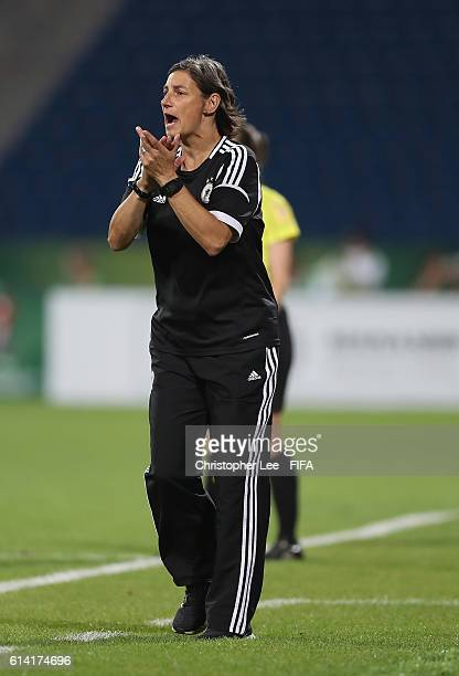 Head Coach Anouschka Bernhard of Germany shouts orders to her players during the FIFA U17 Women's World Cup Jordan 2016 Quarter Final match between...