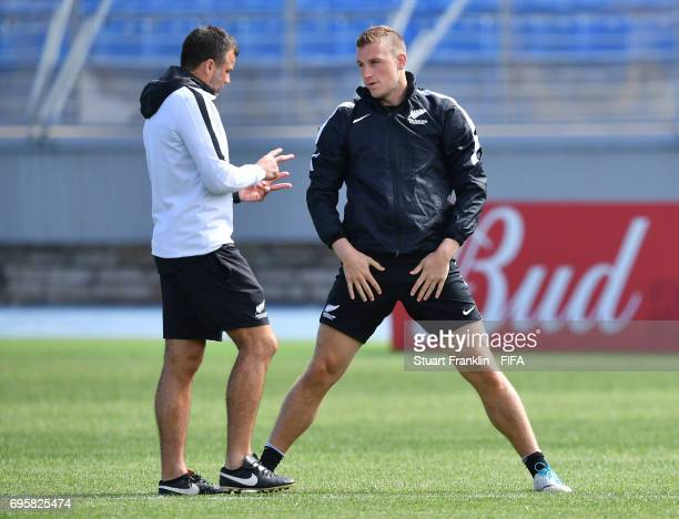 Head Coach Anthony Hudson talks with captain Chris Wood during a training session of the New Zealand national football team on June 14 2017 in Saint...