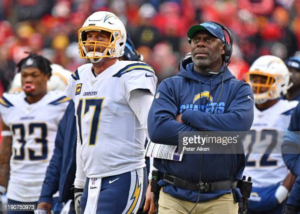 Head coach Anthony Lynn of the Los Angeles Chargers and quarterback Philip Rivers look up at the replay during the second half against the Kansas...