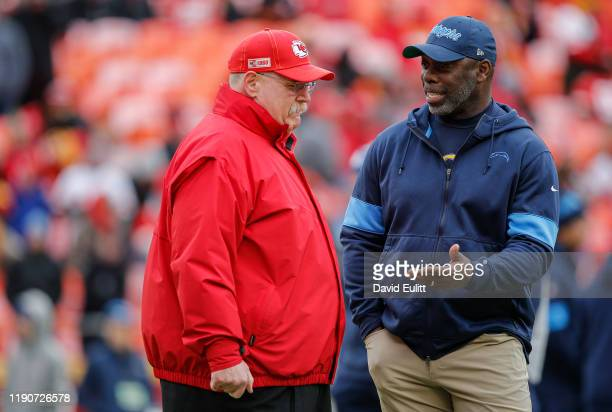 Head coach Anthony Lynn of the Los Angeles Chargers speaks with head coach Andy Reid of the Kansas City Chiefs prior to their game at Arrowhead...