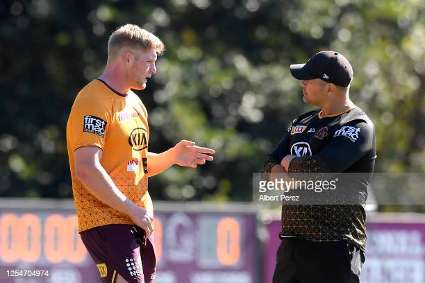 Head coach Anthony Seibold speaks to Thomas Flegler during a Brisbane Broncos NRL training session at the Clive Berghofer Centre on July 07 2020 in...