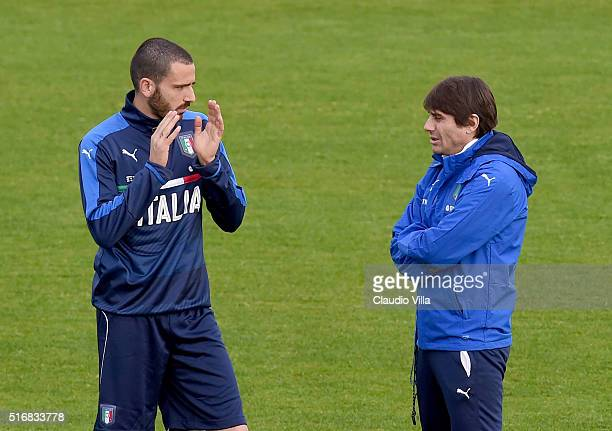 Head Coach Antonio Conte and Leonardo Bonucci chat during the Italy training session at the club's training ground at Coverciano on March 21 2016 in...
