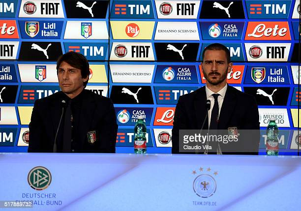 Head coach Antonio Conte and Leonardo Bonucci speak to the media during the Italy press conference at Allianz Arena on March 28 2016 in Munich Germany