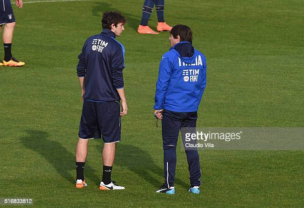Head Coach Antonio Conte and Matteo Darmian chat during the Italy training session at the club's training ground at Coverciano on March 21 2016 in...