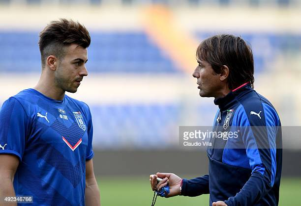 Head coach Antonio Conte and Stephan El Shaarawy chat at the end of Italy training session at Stadio Olimpico on October 12 2015 in Rome Italy