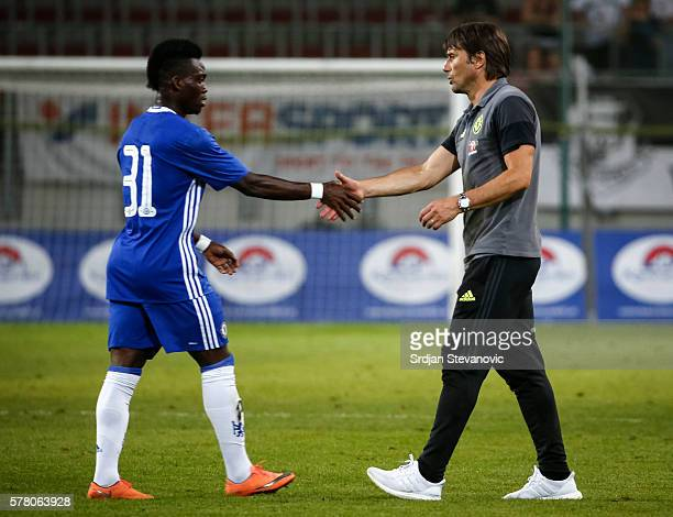Head coach Antonio Konte of Chelsea shake hands with the Christian Atsu after the international friendly match between WAC RZ Pellets and Chelsea FC...