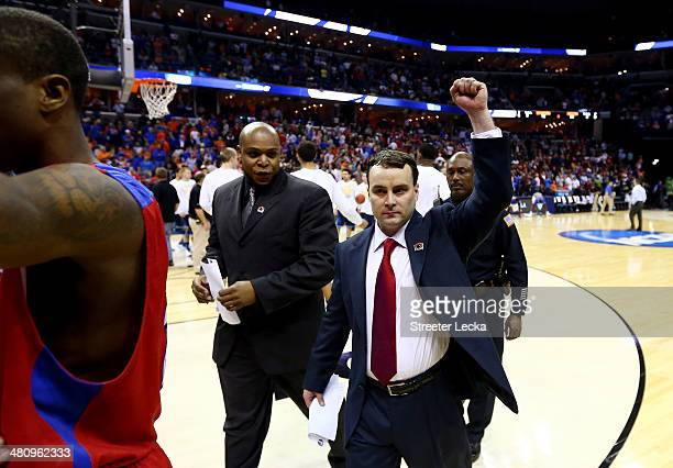Head coach Archie Miller of the Dayton Flyers celebrates after defeating the Stanford Cardinal 82-72 in a regional semifinal of the 2014 NCAA Men's...