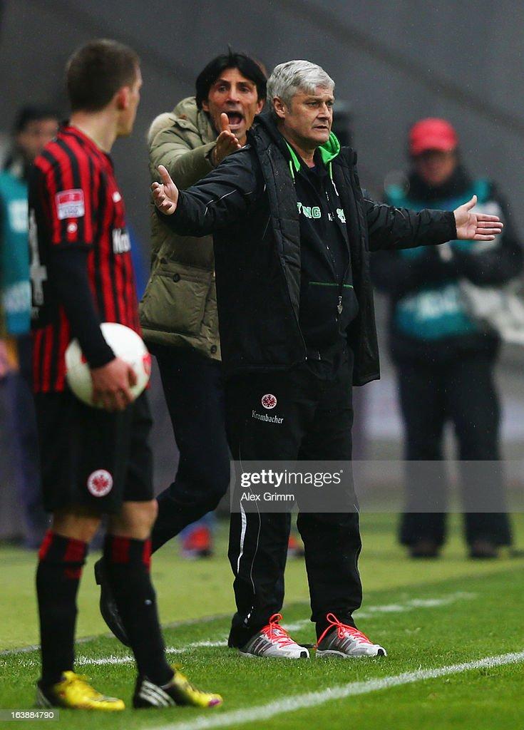 Head coach Armin Veh (front) and manager Bruno Huebner of Frankfurt react during the Bundesliga match between Eintracht Frankfurt and VfB Stuttgart at Commerzbank-Arena on March 17, 2013 in Frankfurt am Main, Germany.