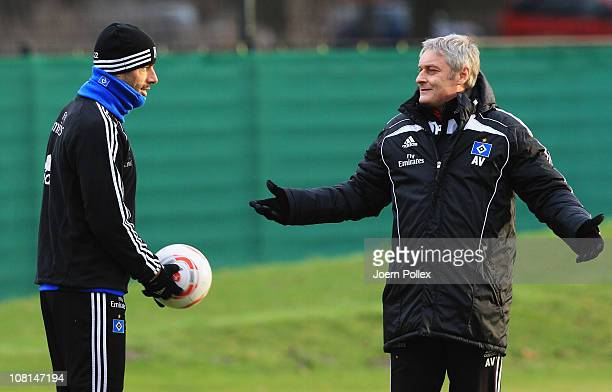 Head coach Armin Veh and Ruud van Nistelrooy chat during the training session of Hamburger SV on January 19 2011 in Hamburg Germany