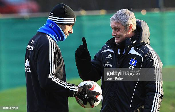 Head coach Armin Veh and Ruud van Nistelrooy chat during the training session of Hamburger SV on January 19, 2011 in Hamburg, Germany.