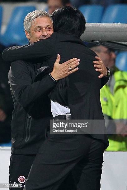 Head coach Armin Veh embraces sporting director Bruno Huebner of Frankfurt after winning 2-0 the Second Bundesliga match between VfL Bochum and...