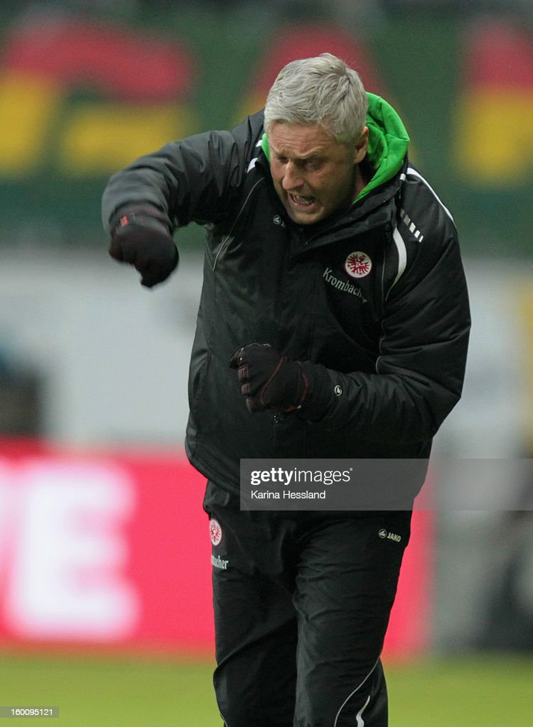 Head coach Armin Veh of Frankfurt celebrates the second goal during the Bundesliga match between Eintracht Frankfurt and 1899 Hoffenheim at Commerzbank-Arena on January 26, 2013 in Frankfurt am Main, Germany.