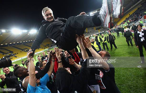 Head coach Armin Veh of Frankfurt is thrown into the air after the Second Bundesliga match between Alemannia Aachen and Eintracht Frankfurt at Tivoli...