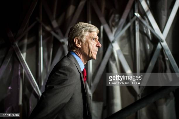 Head Coach Arsene Wenger of Arsenal enters the pitch through the player tunnel prior to the UEFA Europa League group H match between 1 FC Koeln and...