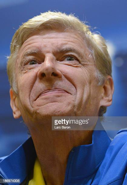 Head coach Arsene Wenger smiles during a Arsenal press conference ahead of the UEFA Champions League Group F match against Borussia Dortmund at...