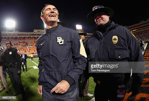 Head coach Art Briles of the Baylor Bears celebrates after the Baylor Bears beat the Oklahoma State Cowboys 45-35 at Boone Pickens Stadium on...