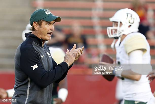 Head coach Art Briles of the Baylor Bears coaches during warm ups before game action against the Iowa State Cyclones at Jack Trice Stadium on...