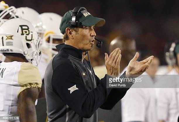 Head coach Art Briles of the Baylor Bears coaches from the sidelines in the first half of play against the Iowa State Cyclones at Jack Trice Stadium...