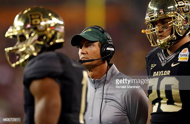 Head coach Art Briles of the Baylor Bears looks on against the UCF Knights during the Tostitos Fiesta Bowl at University of Phoenix Stadium on...
