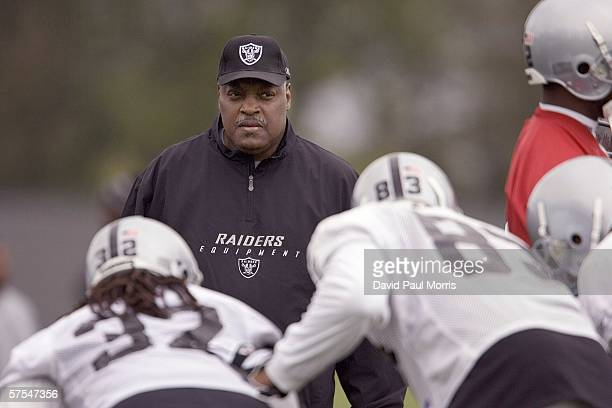 Head coach Art Shell of the Oakland Raiders watches his team practice as the Raiders begin their minicamp on May 6 2006 in Alameda California
