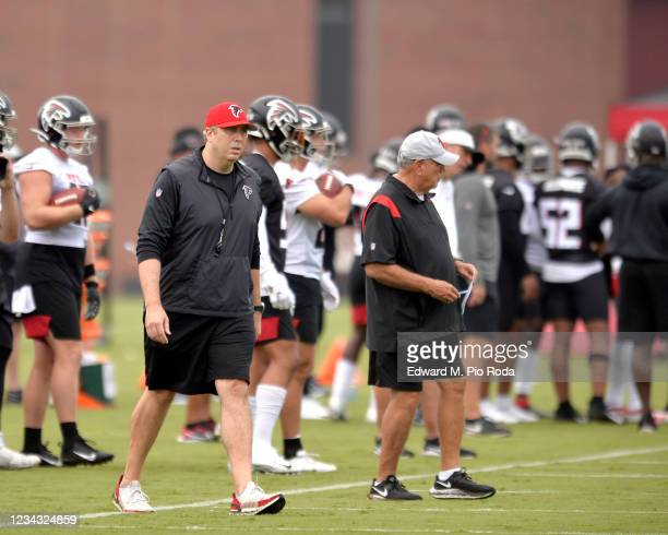 Head Coach Arthur Smith and Defensive Coordinator Dean Pees of the Atlanta Falcons watch from the sideline during training camp at IBM Performance...