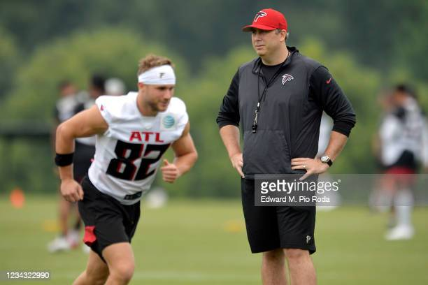 Head coach Arthur Smith of the Atlanta Falcons watches as Austin Trammell warms up during training camp at IBM Performance Field on July 30, 2021 in...