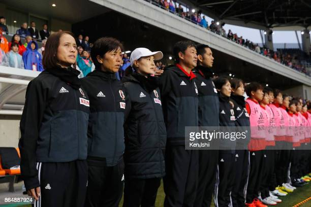 Head coach Asako Takakura of Japan and her staffs and players line up for the national anthems prior to the international friendly match between...