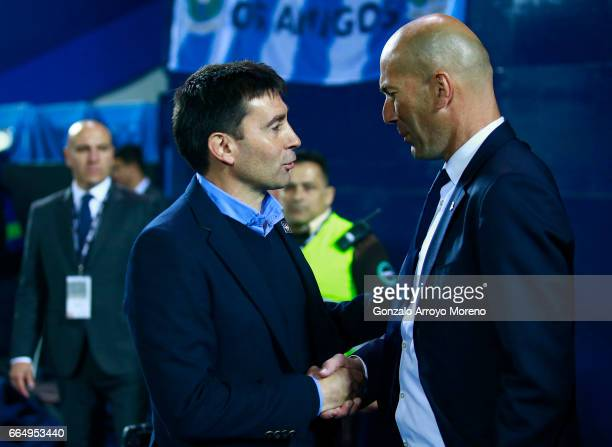 Head coach Asier Garitano shakes hands with coach Zinedine Zidane of Real Madrid CF during the La Liga match between CD Leganes and Real Madrid CF at...