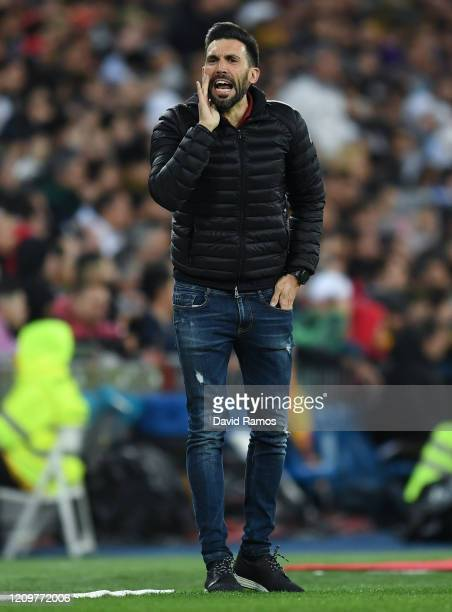 Head coach assistant Eder Sarabia of FC Barcelona gives instructions to his players during the Liga match between Real Madrid CF and FC Barcelona at...