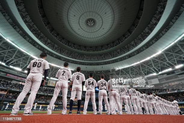 Head coach Atsunori Inaba and players of Japan line up for the national anthem prior to the game two between Japan and Mexico at Kyocera Dome Osaka...