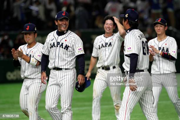 Head coach Atsunori Inaba and Japanese players celebrate after the Eneos Asia Professional Baseball Championship 2017 final game between Japan and...