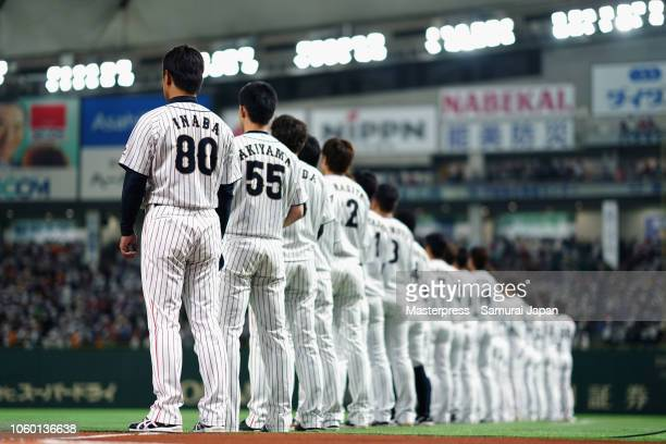 Head coach Atsunori Inaba and Japanese players line up prior to the game three of Japan and MLB All Stars at Tokyo Dome on November 11, 2018 in...