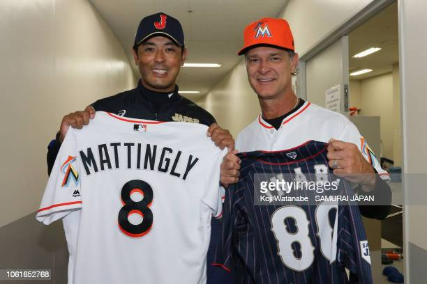Head coach Atsunori Inaba of Japan and Manager Don Mattingly of the Miami Marlins exchange their uniforms prior to the game six between Japan and MLB...