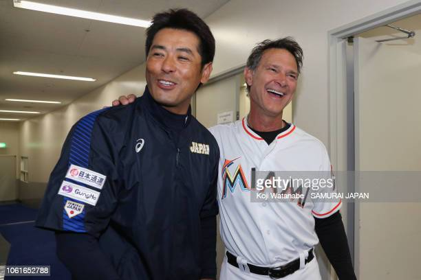 Head coach Atsunori Inaba of Japan and Manager Don Mattingly of the Miami Marlins talk after exchanging their uniforms prior to the game six between...