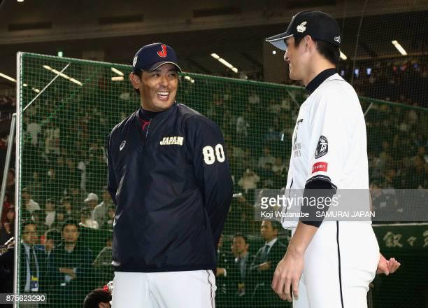 Head coach Atsunori Inaba of Japan and Outfielder Yang DaiKang of Chinese Taipei talk prior to the Eneos Asia Professional Baseball Championship 2017...