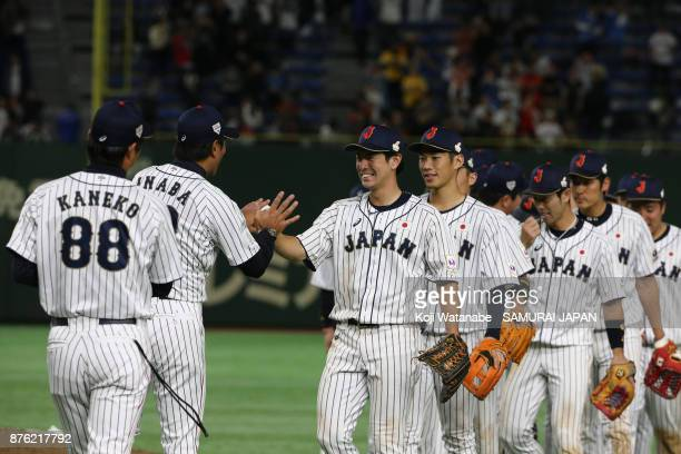 Head coach Atsunori Inaba of Japan congratulates players after the Eneos Asia Professional Baseball Championship 2017 final game between Japan and...