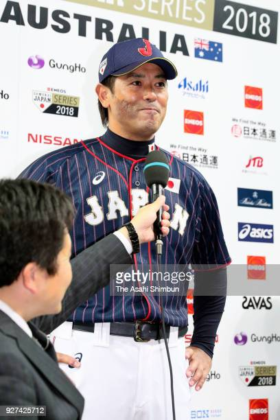 Head coach Atsunori Inaba of Japan is interviewed after his side's 60 victory in the game two of the baseball international match between Japan and...