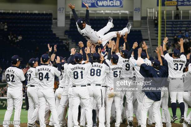 Head coach Atsunori Inaba of Japan is thrown into the air after the Eneos Asia Professional Baseball Championship 2017 final game between Japan and...