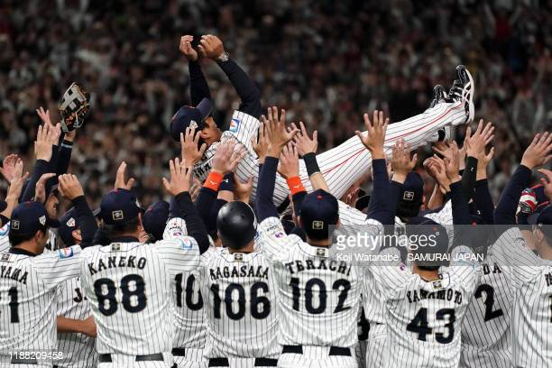 Head coach Atsunori Inaba of Japan is tossed into the air after the WBSC Premier 12 final game between Japan and South Korea at the Tokyo Dome on...